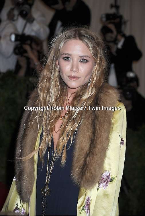 Mary-Kate Olsen attends  the Metropolitan Museum of Art Costume Institute Beneift celebrating the opening of  PUNK: Chaos ..to Couture on May 6, 2013 in New York City.