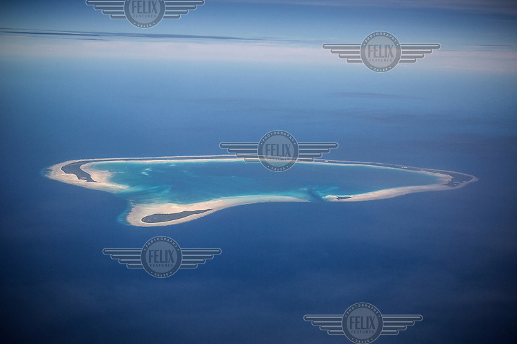 Apememe Atoll. Most of the atolls that make up Kiribati are elevated less than a metre or two above the sea level.