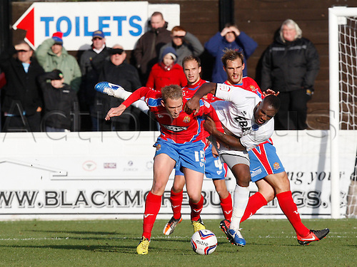 27.10.2012 Dagenham, England: ..Matthew Saunders of Dagenham & Redbridge and Michael Rankine of Aldershot Town ..in action during the League Two match between Dagenham and Redbridge & Aldershot Town from The L.B Barking & Dag Stadium, Victoria Road..