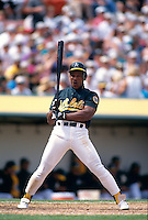 OAKLAND, CA - Rickey Henderson of the Oakland Athletics bats and disagrees with a strike call during a game at the Oakland Coliseum in Oakland, California in 1994. Photo by Brad Mangin