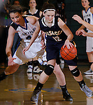 SPEARFISH, S.D. -- March 14, 2014 -- Kaylee Granum #12 of Sioux Valley gets pressure from Ciara Duffy #33 of St. Thomas More during their semifinal game at the 2014 South Dakota State A Girls Basketball Tournament at the Donald E. Young Center in Spearfish, S.D. Friday. (Photo by Dick Carlson/Inertia)