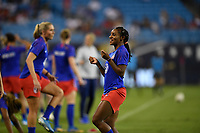 CHARLOTTE, NC - OCTOBER 03: Crystal Dunn #19 of the United States jokes around with teammates prior to their game versus Korea Republic at Bank of American Stadium, on October 03, 2019 in Charlotte, NC.