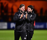 Lincoln City's assistant manager Nicky Cowley, left, and Lincoln City applauds the fans at the final whistle<br /> <br /> Photographer Andrew Vaughan/CameraSport<br /> <br /> The EFL Sky Bet League Two - Cambridge United v Lincoln City - Saturday 29th December 2018  - Abbey Stadium - Cambridge<br /> <br /> World Copyright © 2018 CameraSport. All rights reserved. 43 Linden Ave. Countesthorpe. Leicester. England. LE8 5PG - Tel: +44 (0) 116 277 4147 - admin@camerasport.com - www.camerasport.com