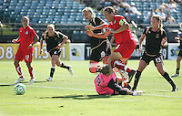 Allison Whitworth (18) protects the goal with Carrie Dew (19) against Abby Wambach (20). FC Gold Pride defeated Washington Freedom 3-2 at Buck Shaw Stadium in Santa Clara, California on August 1, 2009.