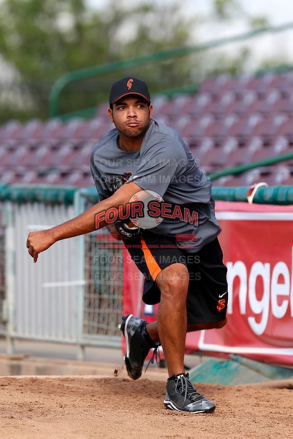 Edwin Escobar #47 of the San Jose Giants throws in the bullpen before a game against the Inland Empire 66'ers at San Manuel Stadium on May 21, 2013 in San Bernardino, California. San Jose defeated Inland Empire, 8-0. (Larry Goren/Four Seam Images)
