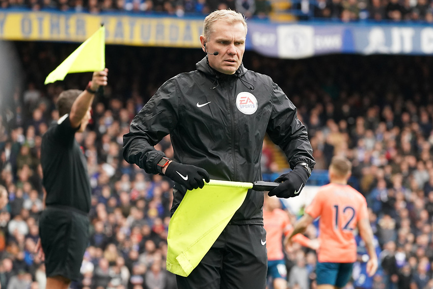 Fourth Official Graham Scott swaps flags with linesman<br /> <br /> Photographer Stephanie Meek/CameraSport<br /> <br /> The Premier League - Chelsea v Everton - Sunday 8th March 2020 - Stamford Bridge - London<br /> <br /> World Copyright © 2020 CameraSport. All rights reserved. 43 Linden Ave. Countesthorpe. Leicester. England. LE8 5PG - Tel: +44 (0) 116 277 4147 - admin@camerasport.com - www.camerasport.com