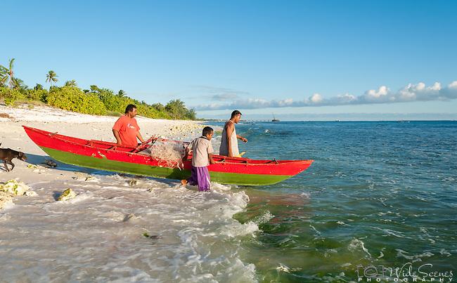 Launching a canoe on the remote island of Kiritimati in Kiribati