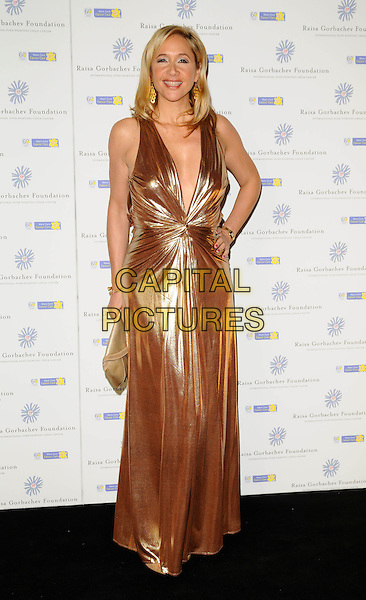 TANIA BRYER.At the Russia Midsummer Fantasy, in aid of the Raisa Gobachev Foundation, Stud House, Home Park, Hampton Court, England, UK, 7th June 2008. .arrivals full length long gold shiny maxi dress hand on hip metallic low cut plunging neckline.CAP/CAN.©Can Nguyen/Capital Pictures
