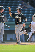 Second baseman Alec Paradowski (15) of the Wofford Terriers scores a run in a SoCon Tournament game against Western Carolina on Wednesday, May 25, 2016, at Fluor Field at the West End in Greenville, South Carolina. Western won, 10-9. (Tom Priddy/Four Seam Images)