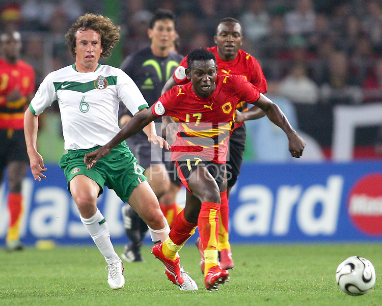 Ze Kalanga (17) of Angola breaks away from Gerardo Torrado (6) of Mexico. Mexico and Angola played to a 0-0 tie in their FIFA World Cup Group D match at FIFA World Cup Stadium, Hanover, Germany, June 16, 2006.