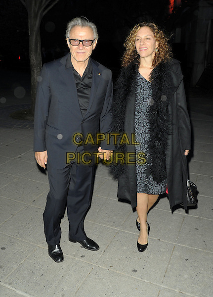 HARVEY KEITEL & DAPHNE KASTNER.9th Annual Tribeca Film Festival - Vanity Fair Party held at at New York State Supreme Court, New York, NY, USA, .20th April 2010..full length black suit glasses holding hands dress coat bag couple married husband wife .CAP/ADM/BM.©Bill Menzel/AdMedia/Capital Pictures.