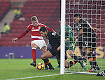 Jake Livermore of Hull City tussles with Viktor Fischer of Middlesbrough on the goal line during the English Premier League match at Riverside Stadium, Middlesbrough. Picture date: December 5th, 2016. Pic Jamie Tyerman/Sportimage