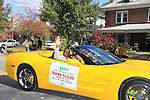 Sports Celebrity Virginia Tech, NFL, WFL wide receiver Shawn Scales and daughter Morgan in yellow corvette at the 33rd Annual Mountain State Apple Harvest Festival (MSAHF) 2012 parade on October 20, 2012 in Martinsburg, West Virginia. (Photo by Sue Coflin/Max Photos)