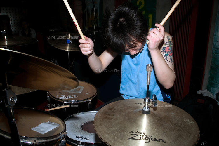 Duwei, drummer for the Chinese punk band Overdose, plays during a concert at Castle Bar in Nanjing, China.