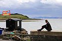 TRAVEL PIECE TO GO WITH GLENN PATTERSON COUNTY DOWN - Glenn Patterson sits near the Kircubbin Car Wash on the Portaferry Road beside Strangford Lough, County Down, Northern Ireland.  Photo/Paul McErlane