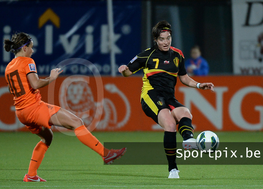 20140212 - ZWOLLE , THE NETHERLANDS : Belgian Cecile De Gernier (r) pictured during the female soccer match between The Netherlands and Belgium , on the fifth matchday in group 5 of the UEFA qualifying round to the FIFA Women World Cup in Canada 2015 at Het Ijseldelta Stadion , Zwolle . Wednesday 12th February 2014 . PHOTO DAVID CATRY