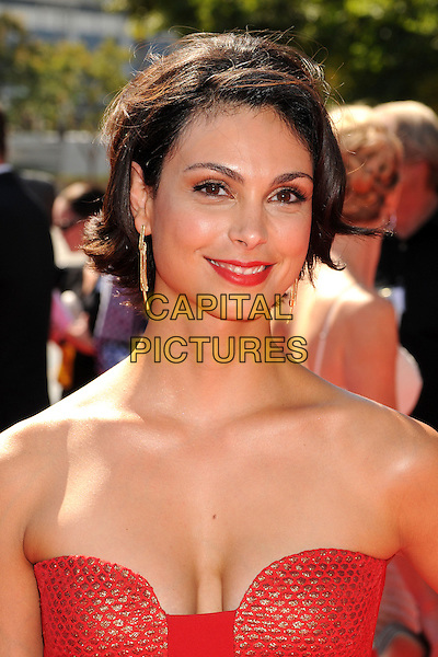 Morena Baccarin.2012 Creative Arts Emmy Awards - Arrivals held at the Nokia Theatre L.A. Live, - Los Angeles, California, USA, 15th September 2012..emmys portrait headshot red strapless cleavage .CAP/ADM/BP.©Byron Purvis/AdMedia/Capital Pictures.