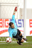 Louisville Cardinals goalkeeper Andre Boudreaux (30) dives for a ball duringthe penalty kick shootout. The Louisville Cardinals defeated the Providence Friars 3-2 in penalty kicks after playing to a 1-1 tie during the finals of the Big East Men's Soccer Championship at Red Bull Arena in Harrison, NJ, on November 14, 2010.