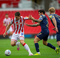4th July 2020; Bet365 Stadium, Stoke, Staffordshire, England; English Championship Football, Stoke City versus Barnsley; Sam Vokes of Stoke City under pressure from Alex Mowatt of Barnsley