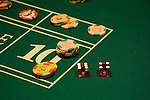Craps table dice and chips in las Vegas Nevada, Caesars Palace and Casino, gaming, gambling, craps, craps table, dice, die, NV, Las Vegas, Photo nv220-16950..Copyright: Lee Foster, www.fostertravel.com, 510-549-2202,lee@fostertravel.com