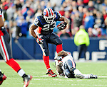 1 November 2009: Buffalo Bills' running back Marshawn Lynch gains 5 yards in the third quarter against the Houston Texans at Ralph Wilson Stadium in Orchard Park, New York, USA. The Texans defeated the Bills 31-10. Mandatory Credit: Ed Wolfstein Photo