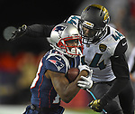 (Foxboro, MA, 01/21/18) New England Patriots wide receiver Phillip Dorsett, left, catches the ball under Jacksonville Jaguars outside linebacker Myles Jack during the fourth quarter of the AFC championship NFL football game at Gillette Stadium on Sunday, January 21, 2018. Photo by Christopher Evans