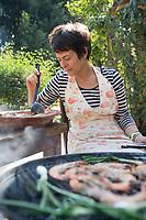 Annuska cooking shrimp on the BBQ. Cuatepetitla house with Obie, San Jose de los Laureles, Morelos, Mexico