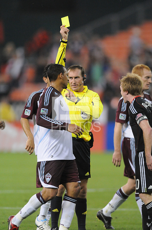 MLS referee Terry Vaughn gives a yellow card.    DC United tied The Colorado Rapids 1-1, at RFK Stadium, Saturday  May 14, 2011.