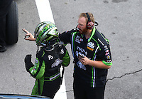 Jun 17, 2016; Bristol, TN, USA; Crew member with NHRA funny car driver Alexis DeJoria during qualifying for the Thunder Valley Nationals at Bristol Dragway. Mandatory Credit: Mark J. Rebilas-USA TODAY Sports