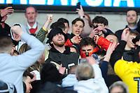 Joe Rodon (centre) of Swansea City and Oli McBurnie (left) during the Sky Bet Championship match between Cardiff City and Swansea City at the Cardiff City Stadium in Cardiff, Wales, UK. Sunday 12 January 2020