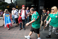 USA and Mexico fans run into each other outside the Galeria Plaza hotel before the USA vs. Mexico World Cup Qualifier at Azteca stadium in Mexico City, Mexico on March 26, 2013.
