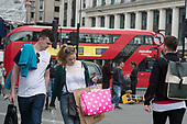 Young couple shopping in Oxford Street, London.