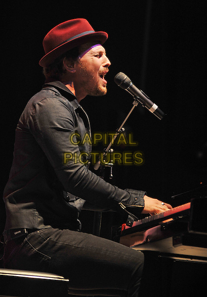 Singer GAVIN DEGRAW performs at a stop on his 2012 U.S. Tour held at the Stage AE, Pittsburgh, PA., USA..May 29th, 2012.on stage in concert live gig performance performing music half length black jacket jeans denim singing hat sitting piano side profile .CAP/ADM/JN.©Jason L Nelson/AdMedia/Capital Pictures.