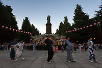 Bon Odori dancing around a statue of Ōmura Masujirō: at the Mitama matsuri at the controversial Yasukuni Shrine in Kudanshita, Tokyo, Japan. Friday July 14th 2017. The Mitama Matsuri is one of Japan's largest Obon festivals with over 300,000 visiting the shrine to pay respect to ancestors during the 4 days it lasts. Obon is festival of remembrance for ancestors who are believed to come back from the other world and visit the living at this time. Yasukuni Shrine, which houses the spirits of the Japanese war dead, celebrates these spirits with 30,00 yellow lanterns and mikoshi parades and traditional dancing. The festivals runs from July 13th to 16th.