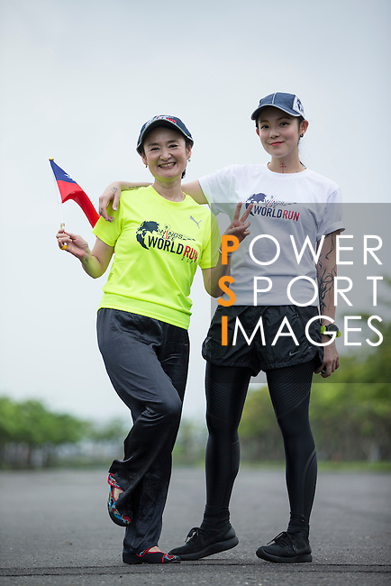Wings for Life Ambassador and Runner/Writer Gin Ouyang (left) and Cheerer on Speaker Car Ai Jen Tan (right) pose for a photograph during the Wings for Life World Run on 08 May, 2016 in Yilan, Taiwan. Photo by Victor Fraile / Power Sport Images