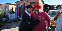 A lady show Respect for Nombuso Keme, a well known Sangoma (spiritual healer) in the Township of Delpht east of Cape Town. SA 2009