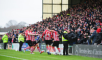 Lincoln City's Harry Toffolo, second in from right, celebrates scoring the opening goal with team-mates, from left, Lee Frecklington, Neal Eardley and Michael Bostwick<br /> <br /> Photographer Chris Vaughan/CameraSport<br /> <br /> The EFL Sky Bet League Two - Lincoln City v Grimsby Town - Saturday 19 January 2019 - Sincil Bank - Lincoln<br /> <br /> World Copyright © 2019 CameraSport. All rights reserved. 43 Linden Ave. Countesthorpe. Leicester. England. LE8 5PG - Tel: +44 (0) 116 277 4147 - admin@camerasport.com - www.camerasport.com