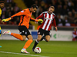 Matt Done of Sheffield Utd chases down a loose ball during the League One match at Bramall Lane Stadium, Sheffield. Picture date: September 27th, 2016. Pic Simon Bellis/Sportimage