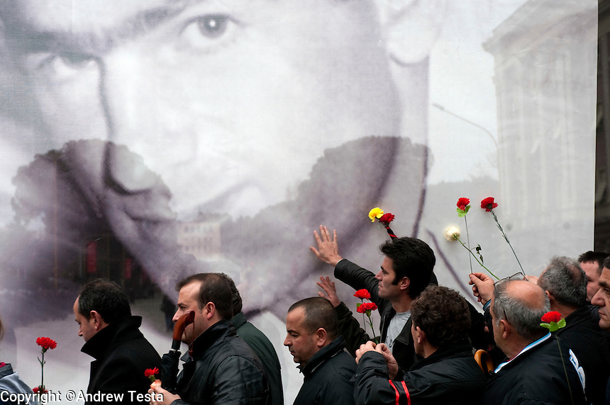 Albania. Tirana. 28th January 2011..Mourners pay their respects as they pass the spot where three people were shot dead =during anti Government protests. Tens of thousands attended the silent demonstration in honour of the victims..©Andrew Testa for the New York Times..