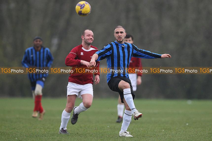 Maynell (blue/black stripes) vs Haggerston Nomads (maroon) - Hackney & Leyton Sunday League Football at South Marsh, Hackney Marshes, London - 13/03/11 - MANDATORY CREDIT: Gavin Ellis/TGSPHOTO - Self billing applies where appropriate - Tel: 0845 094 6026