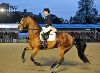 16.05.2014.  Windsor Horse Show London, Nikki Crisp (GBR) riding Pasoa during the CD13* FEI Grand Prix Freestyle to music
