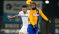 Max Muller of Wycombe Wanderers beats Yoann Arquin of Mansfield Town to the ball during the The Checkatrade Trophy  Quarter Final match between Mansfield Town and Wycombe Wanderers at the One Call Stadium, Mansfield, England on 24 January 2017. Photo by Andy Rowland.