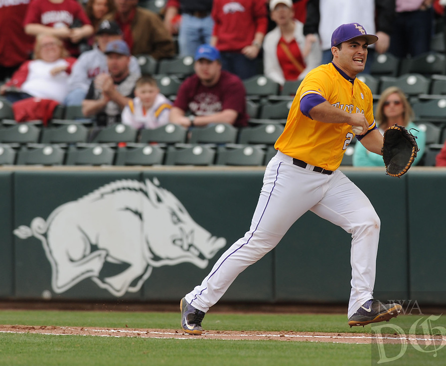 NWA Democrat-Gazette/ANDY SHUPE - First baseman Chris Chinea of LSU celebrates a double play against Arkansas to end an Arkansas rally in the seventh inning Saturday, March 21, 2015, at Baum Stadium in Fayetteville. Visit nwadg.com/photos for more photos from the game.