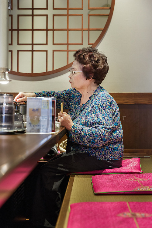 Osaka, Japan, November 25 2016 - In a restaurant of Osaka&rsquo;s Korea town in Tsuruhashi, the home of the largest Korean community (Zainichi) in Japan.<br /> The majority of Koreans in Japan are Zainichi Koreans, often known simply as Zainichi , who are the permanent ethnic Korean residents of Japan. The term &quot;Zainichi Korean&quot; refers only to long-term Korean residents of Japan who trace their roots to Korea under Japanese rule, distinguishing them from the later wave of Korean migrants who came mostly in the 1980s. The estimated population is about 500,000 people. As of 2016, about 90% of them have South Korean nationality and 10% of them are considered by Japanese administration as &laquo;&nbsp;Korean&nbsp;&raquo; (chosenjin), the word used for korean people before the division between North and South Korea in 1948. The ratio used to be the opposite in the 1950ies.