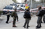 Israeli soldiers gather at the scene where a Palestinian, who according to the Israeli military attempted to stab a soldier, was shot dead, near a check point of the Israeli settlement of Kiryat Arba in the the West Bank city of Hebron on September 3, 2018. Photo by Wisam Hashlamoun