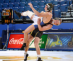 BROOKINGS, SD - JANUARY 11:  Austin Oyen from South Dakota State University slams Mito Mendivil from Dakota Wesleyan to the mat in their 149 pound match Sunday afternoon at Frost Arena in Brookings. (Photo by Dave Eggen/Inertia)
