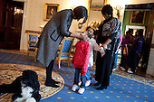 First Lady Michelle Obama greets a young visitor touring the White House during a surprise visit in the Blue Room with family dog Bo on the anniversary of the inauguration, Wednesday, January 20, 2010.  .Mandatory Credit: Samantha Appleton - White House via CNP