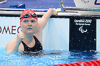 PICTURE BY ALEX BROADWAY /SWPIX.COM - 2012 London Paralympic Games - Day Five - Swimming, Aquatic Centre, Olympic Park, London, England - 03/09/12 - Susannah Rodgers of Great Britain reacts after the Women's 100m Freestyle S7 Heats.