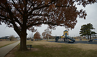 NWA Democrat-Gazette/ANDY SHUPE<br /> A large tree stands Thursday, Dec. 28, 2017, in Luther George Grove Street Park in downtown Springdale. The city of Springdale received a $642,638 grant from the Walton Family Foundation meant to begin implementation of the city's Downtown Master Plan and help fund improvements at nearby Luther George Grove Street Park.