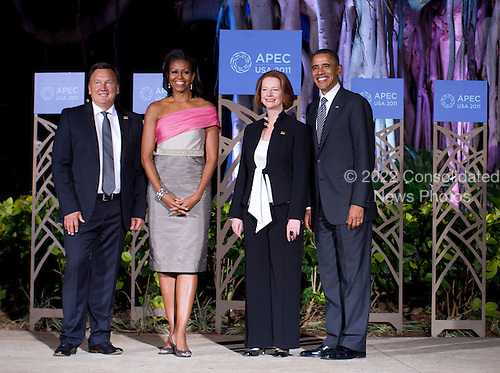United States President Barack Obama (R) and First Lady Michelle Obama (2nd L) pose for a portrait with Australian Prime Minister Julia Gillard (2nd R) and her parter Tim Mathieson (L) before the Asia-Pacific Economic Cooperation (APEC) summit dinner at the Hale Koa Hotel in Honolulu, Hawaii on Saturday, November 12, 2011..Credit: Kent Nishimura / Pool via CNP